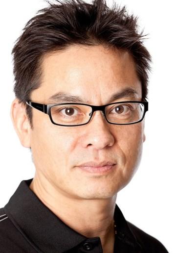 Headshot of Filipino man with glasses