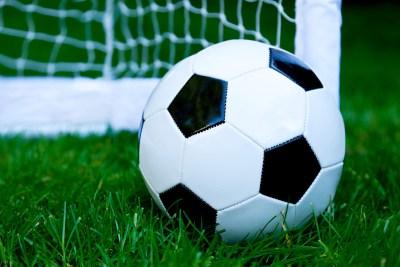 Shot of football on grass