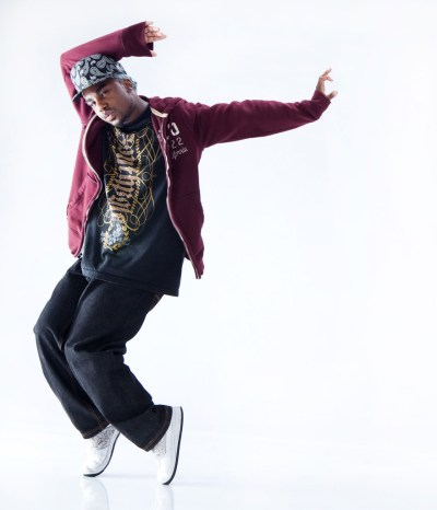 Male hip hop dancer standing on toes