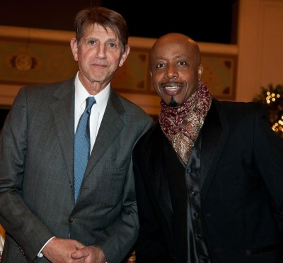 Peter Coyote and MC Hammer posing for camera