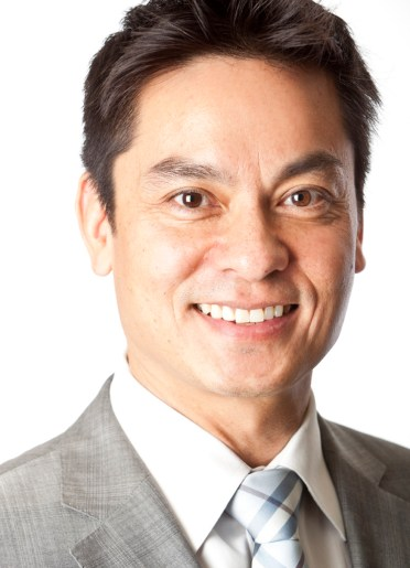 Headshot of smiling Filipino actor