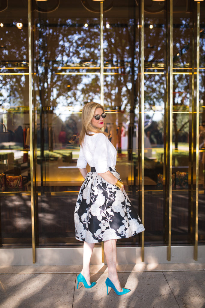 Pairing an Eliza J midid skirt with a white button down shirt and blue heels.