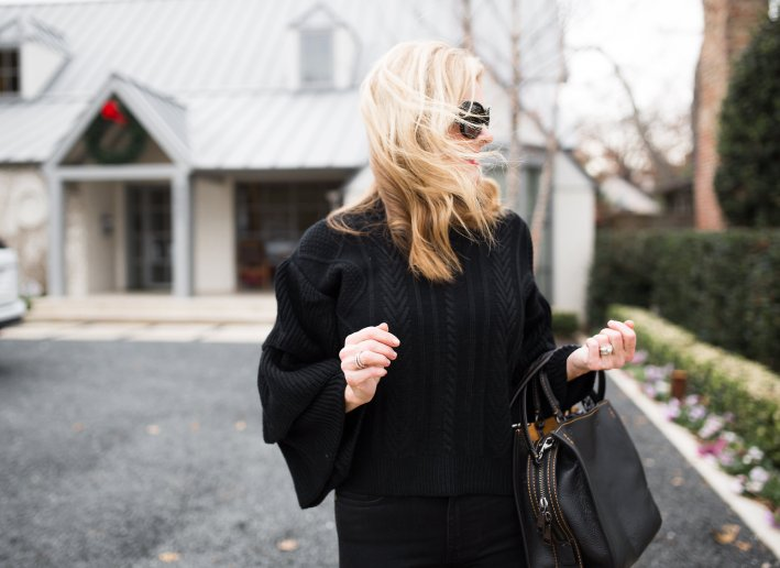 Chicwish black bell sleeve sweater paired with Frame black denim