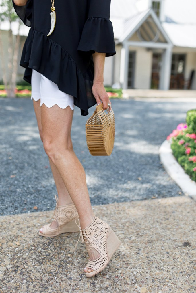 Pairing a Gibson handkerchief hem top from Nordstrom with scalloped edge white shorts from Talbots with wedge heels and Cult Gaia ark bag.
