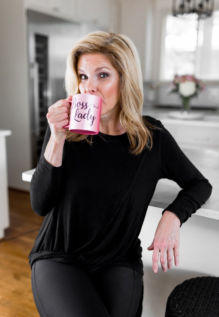 Tanya Foster drinking coffee in her workout clothes