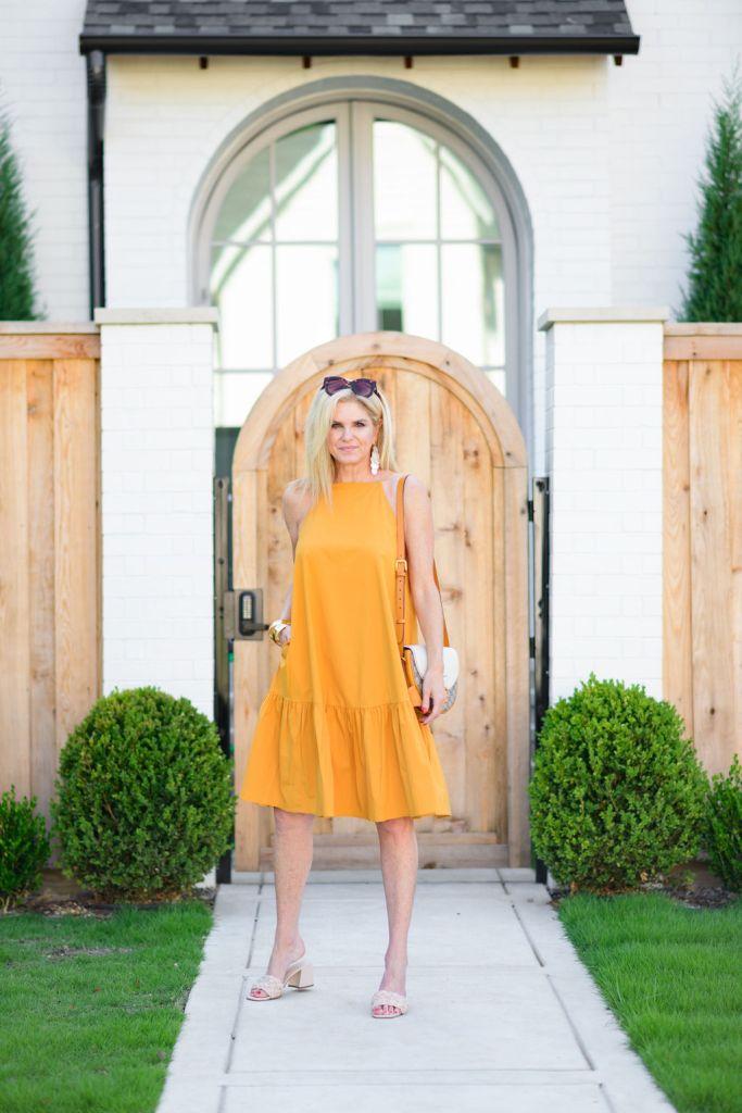 Tanya Foster wearing yellow square neck flounce shift dress