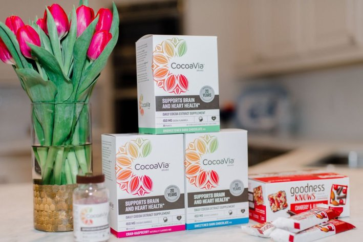 Support your brain and heart health with CocoaVia™ daily supplement stick packs, capsules and goodness knows snack squares on a counter