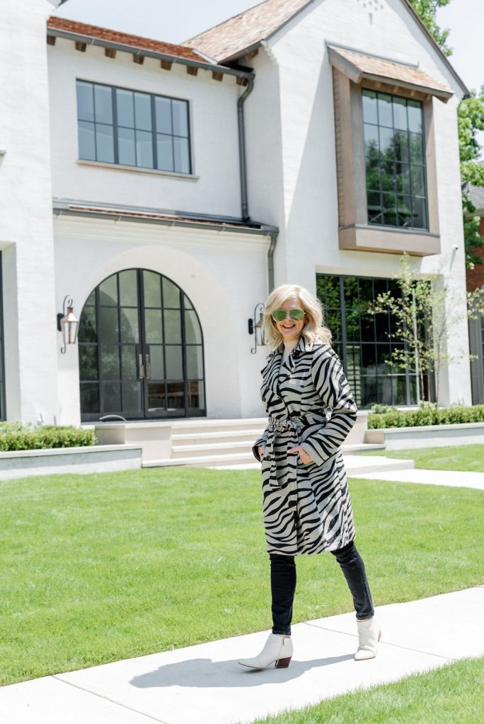 Fall Fashion from Friends of Ann Taylor Sale | Seasonal Style with Ann Taylor Fall 2019 by popular Texas fashion blogger, Tanya Foster: image of a woman standing outside and wearing a Ann Taylor Zebra Print Trench Coat and Ann Taylor Seasonless Yarn Mock Neck Sweater Shell.