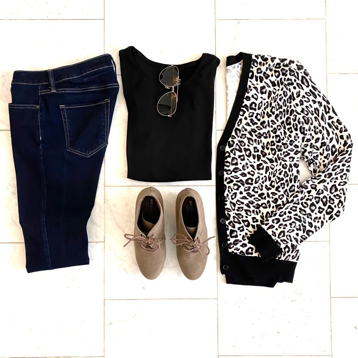 flat lay clothes on the floor with animal print cardigan and skinny jeans