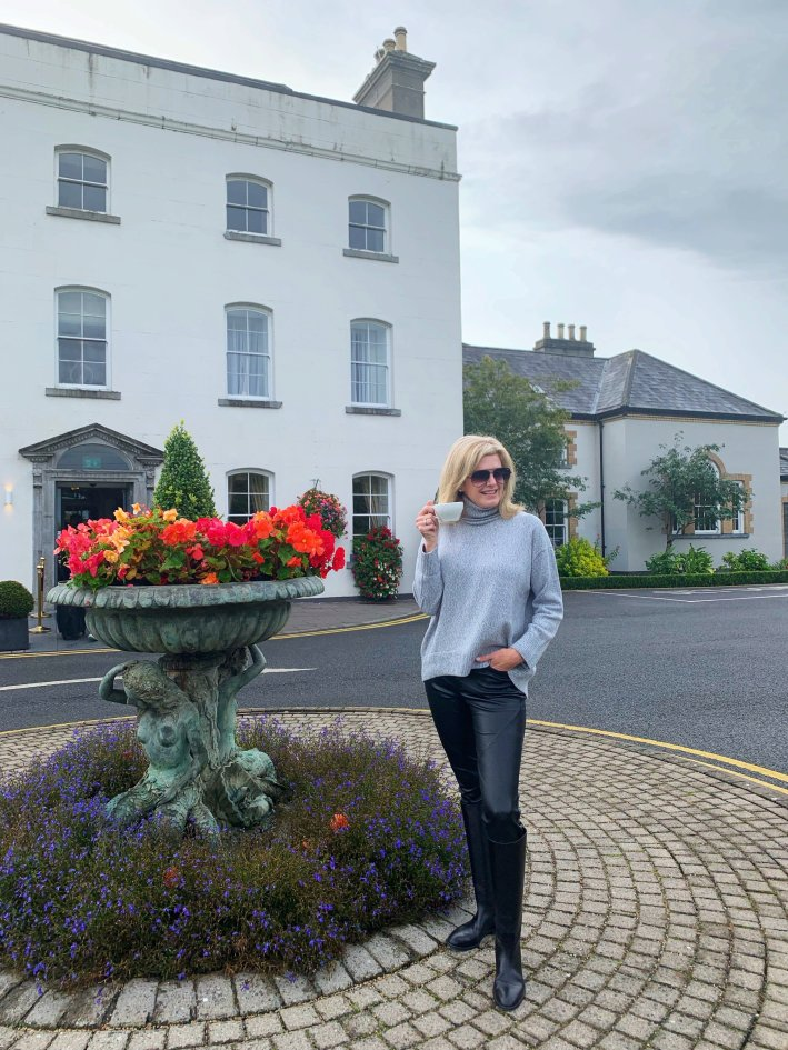 The Johnstown Estate, Ireland | 8 Reasons to travel to Ireland now! by popular Dallas travel blogger, Tanya Foster: image of standing outside of the Johnstown Estate in Ireland.