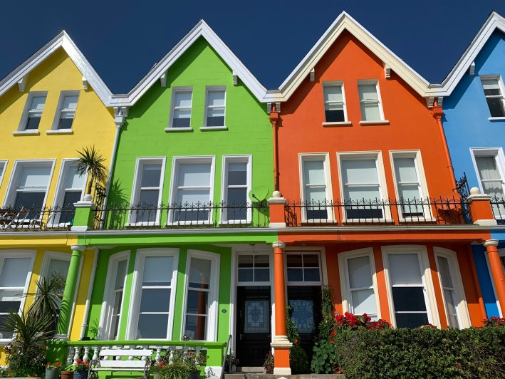 Whitehead, Northern Ireland | 8 Reasons to travel to Ireland now! by popular Dallas travel blogger, Tanya Foster: image of colorful buildings in Whitehead Northern Ireland.