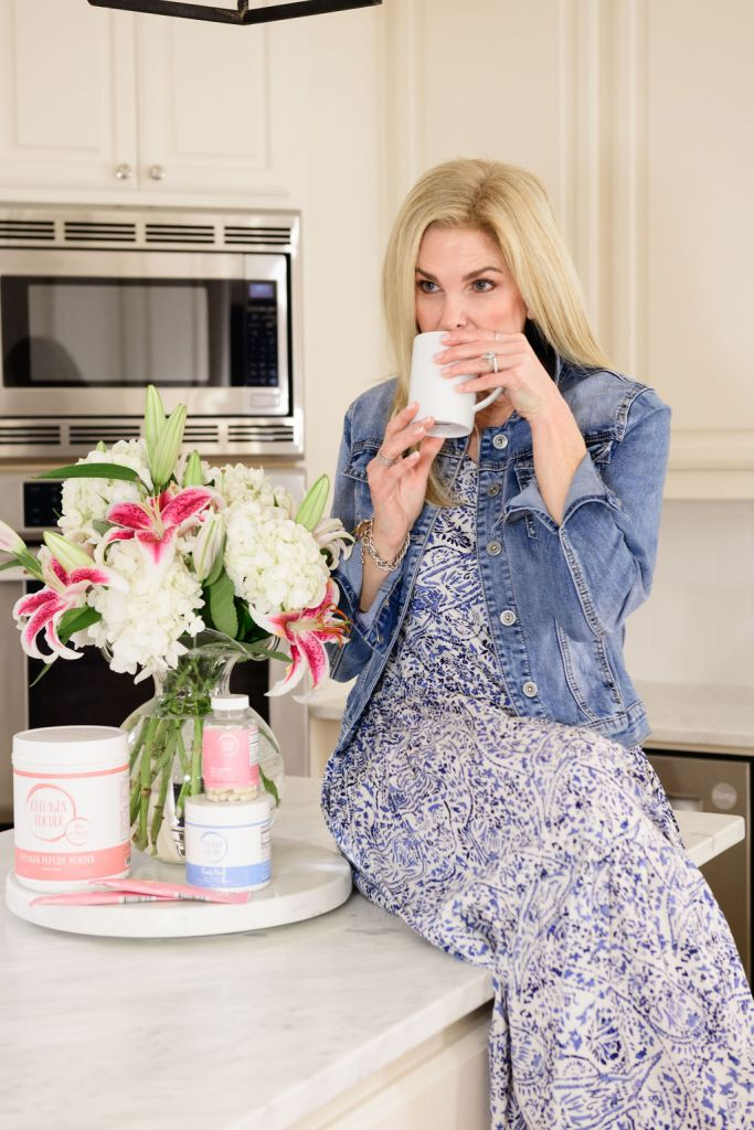tanya foster sipping coffee next to collagen for her products