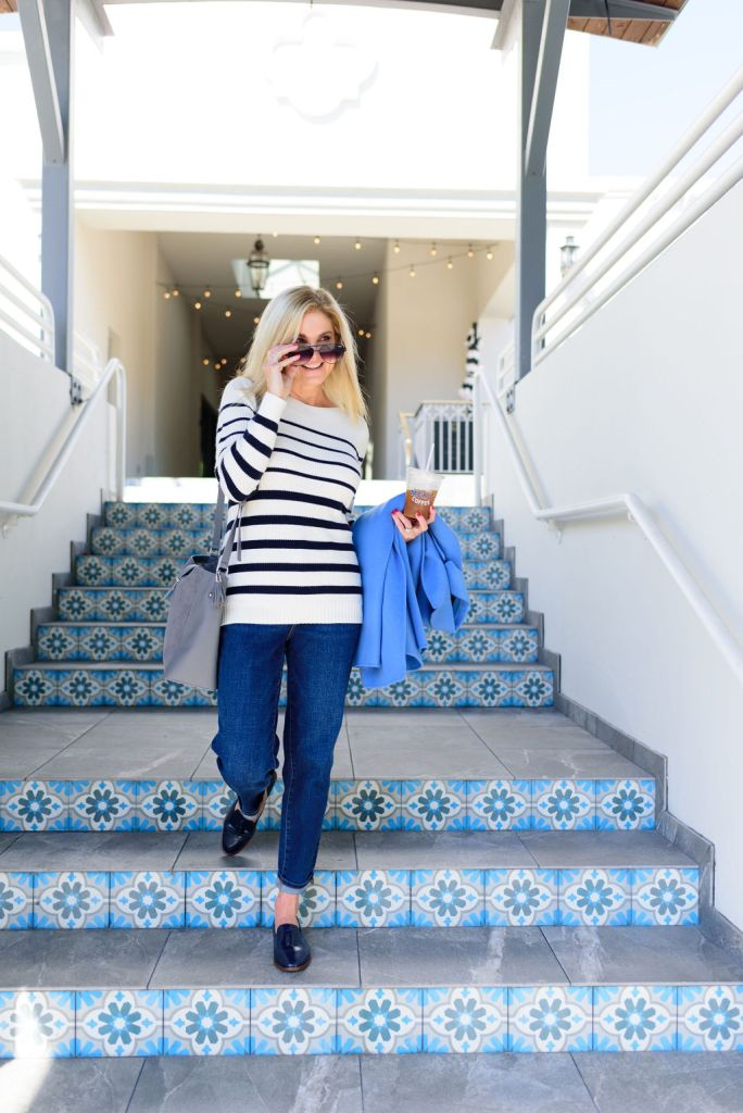 Tanya Foster walking down steps in Talbots sweater, coat, jeans and mules