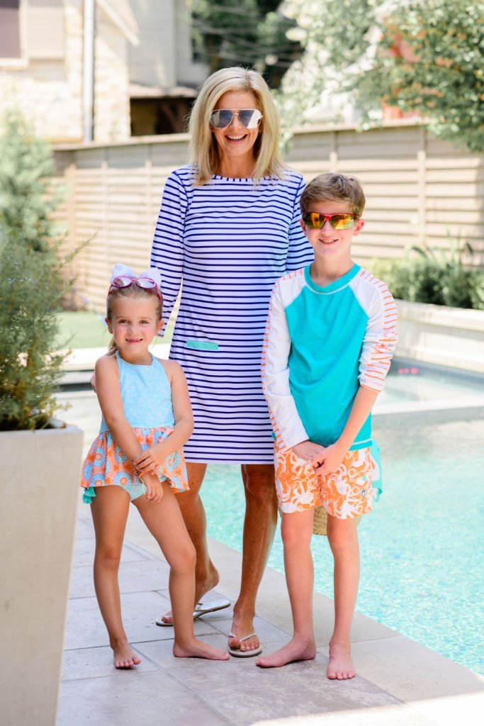 Tanya Foster in cabana life dress with boy in cabana life trunks and rashguard and girl in cabana life swimsuit