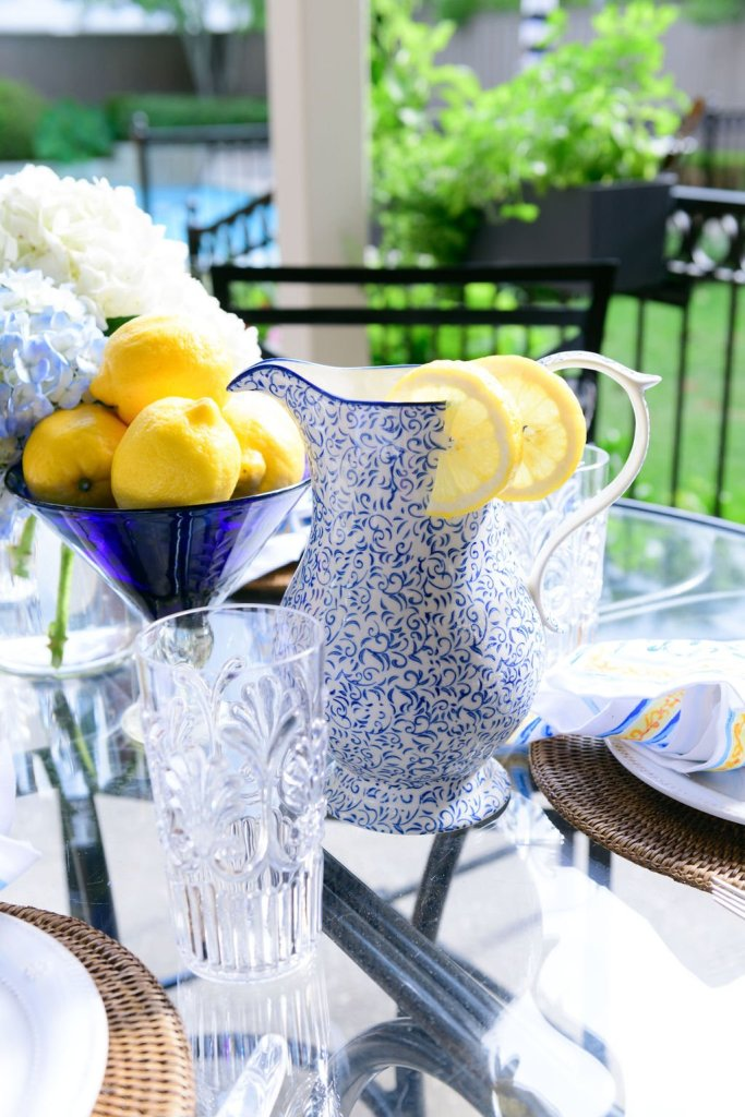 outdoor table setting with attington pitcher and lemons