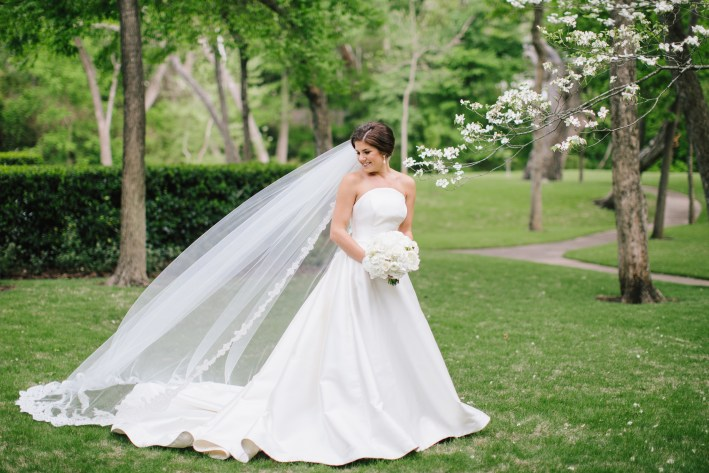 Taylor Foster in Patti Flowers custom bridal gown and veil