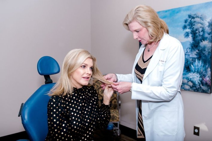 Tanya Foster with Dr. Lori Stetler analyzing hair thinning problems
