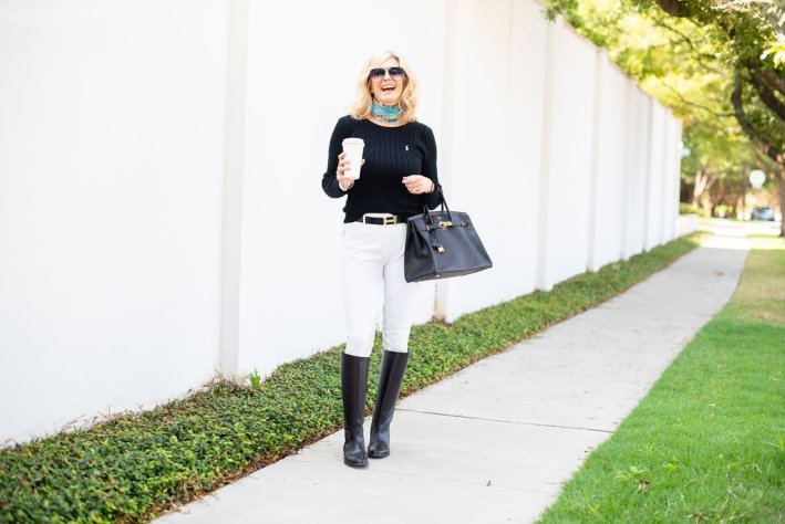 5 Style Tips for a Classic Look | 5 Style Tips for a Classic Look | 5 Tips for Creating Classic Style Fashion by popular Dallas fashion blogger, Tanya Foster: image of woman standing outside and wearing a black POLO RALPH LAUREN Cable-Knit Cotton Sweater, HERMÈS Reversible H 32mm Belt Kit, Gucci silk scarf, ECP RideTex Competition Breeches White, black knee-high boots, and holding a black Prada Saffiano Cuir Double Small Tote Bag.