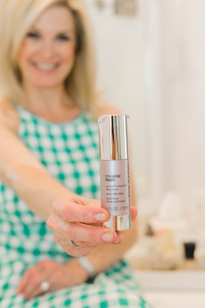 TimeWise Repair® Volu-Firm® Advanced Lifting Serum | Product Review: Mary Kay TimeWise Repair® Volu-Firm® Lifting Serum by popular luxury beauty blogger, Tanya Foster: image of a woman holding a bottle of Mary Kay TimeWise Repair® Volu-Firm® Lifting Serum.