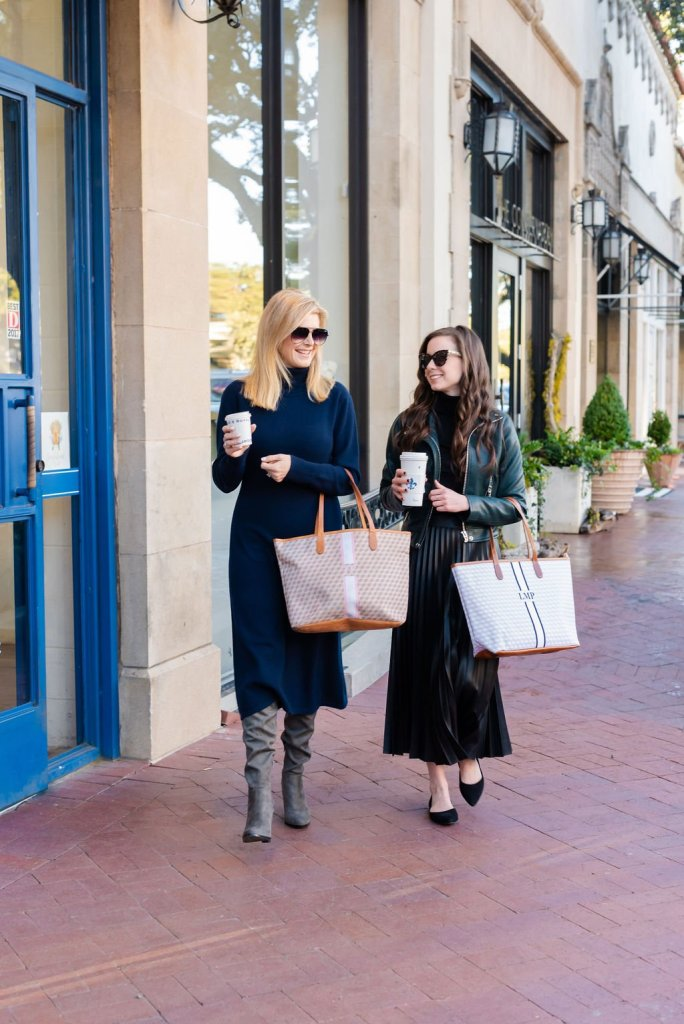 Tanya Foster and Laura Pearson on a sidewalk with monogrammed tote bags