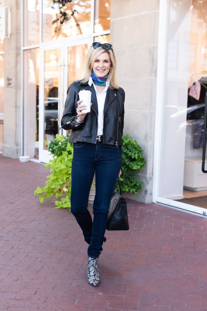 Black moto jacket with skinny jeans for fall 2019
