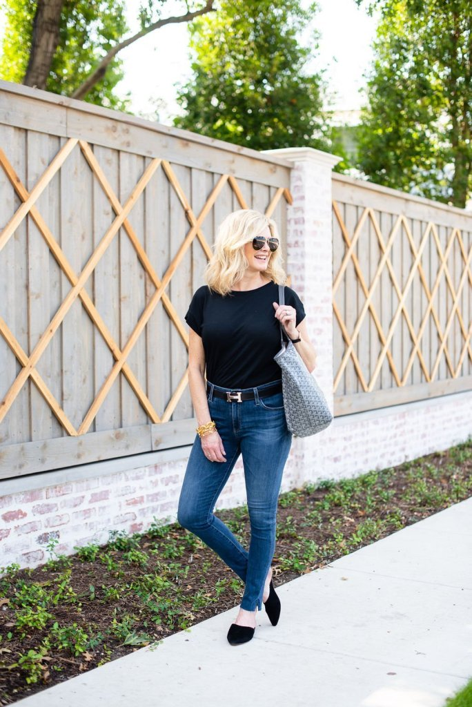 How to Wear a Black Tee 2 Ways by popular Texas fashion blogger, Tanya Foster: image of a woman wearing a Madewell Northside Vintage Tee, AG The Farrah High Waist Ankle Skinny Jeans, Hermes belt, and Madewell Remi Mule.