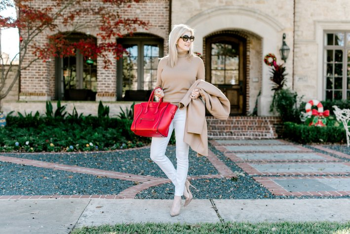 Everlane coat and turtleneck with red Celine bag.
