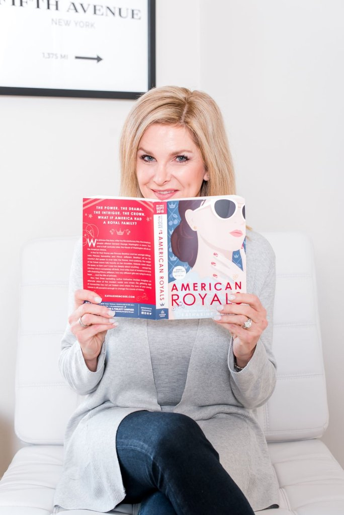 Tanya Foster holding the book American Royals
