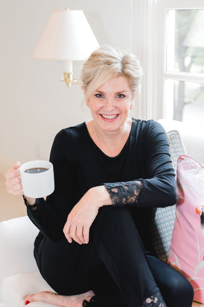 7 Ways to relax | 7 Easy Ways to Relax by popular Dallas life and style blogger, Tanya Foster: image of a woman sitting on her couch and holding a cup of coffee.