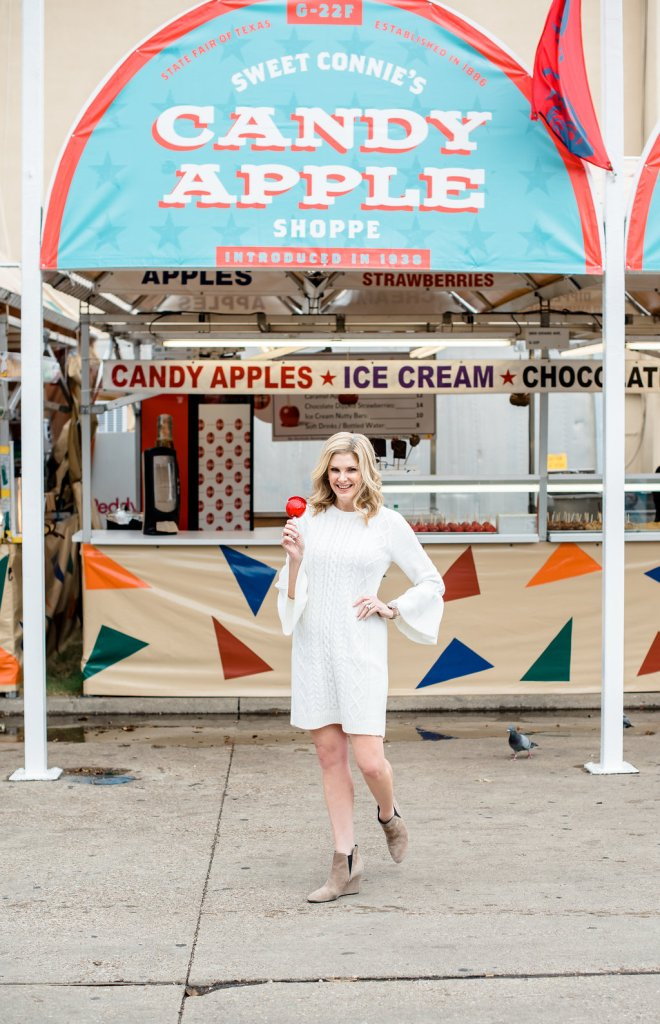 Eliza J cable knit dress with booties at the State Fair of Texas and a candied apple