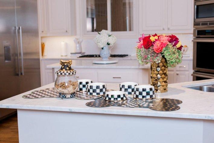 mackenzie-childs pet bowls in a kitchen