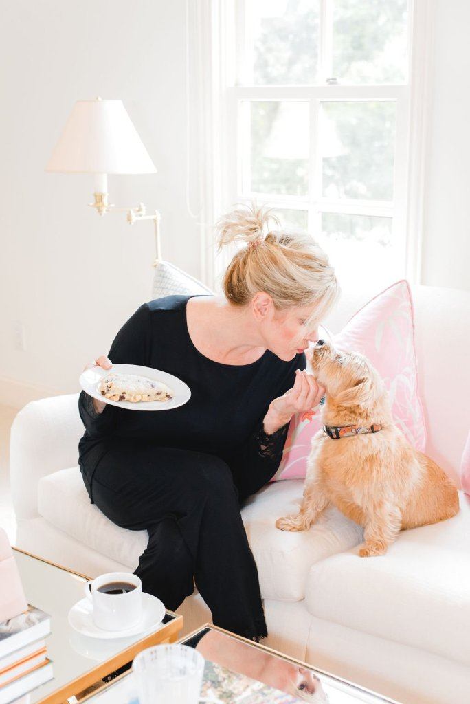 7 ways to relax | 7 Easy Ways to Relax by popular Dallas life and style blogger, Tanya Foster: image of a woman sitting on her couch with her dog.