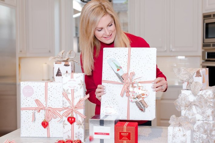 Tanya Foster holding a gift