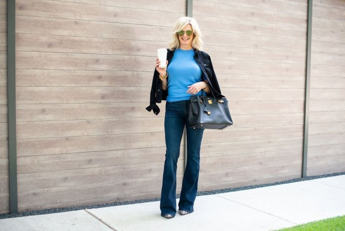 Frame flare denim and snakeskin booties | Trend Focus : How to Wear Flare Jeans by popular Dallas fashion blogger, Tanya Foster: image of a woman standing outside and wearing Nordstrom Frame Le High Waist Flare Jeans and Nordstrom Jeffrey Campbell Raven Booties.