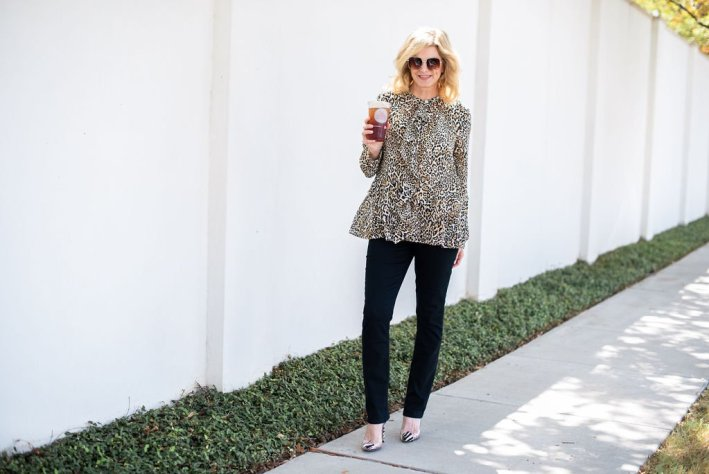 Chico's Animal Print collection for fall 2019 by popular Dallas fashion blogger, Tanya Foster: image of a woman wearing a Chico's SILKY SOFT DOTTED CHEETAH-PRINT HALF-PLACKET SHIRT and Chico's GIRLFRIEND JEANS.