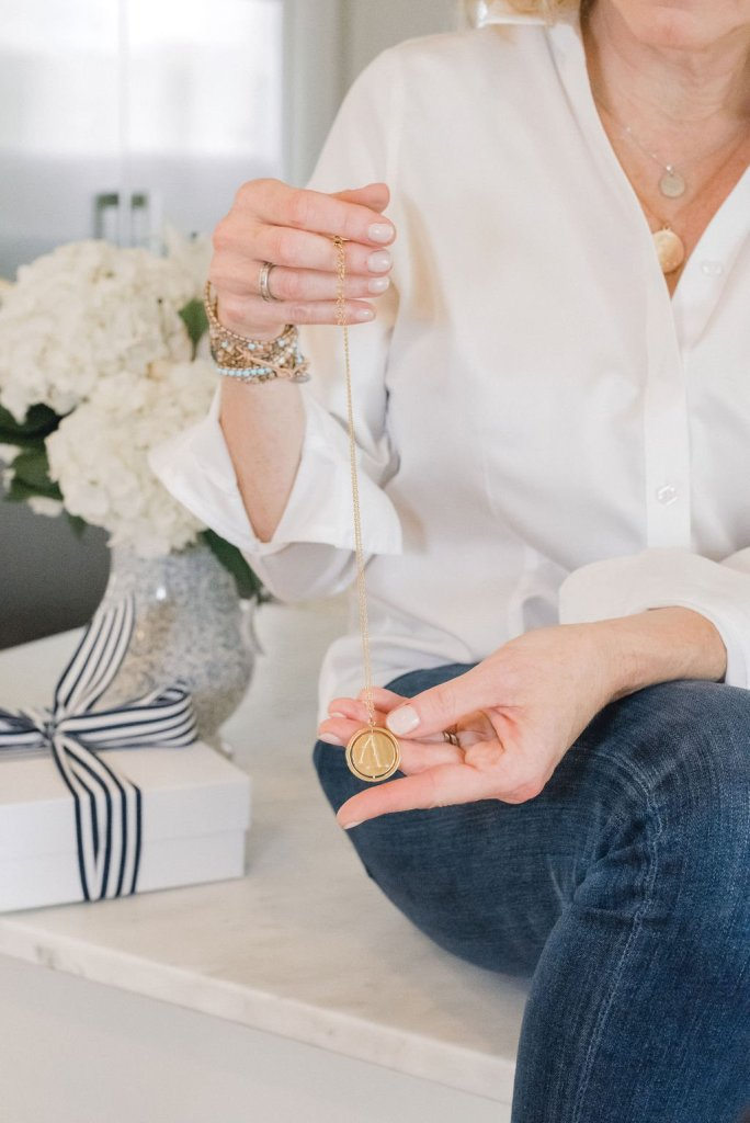 Victoria Emerson | The Columbus Day Victoria Emerson SALE! by popular Dallas fashion blogger, Tanya Foster: image of woman holding a Victoria Emerson necklace.