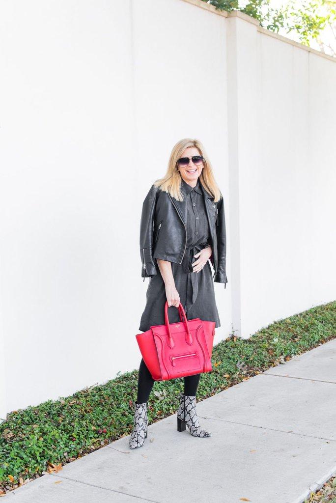 Tanya Foster standing on a sidewalk in a wrap dress