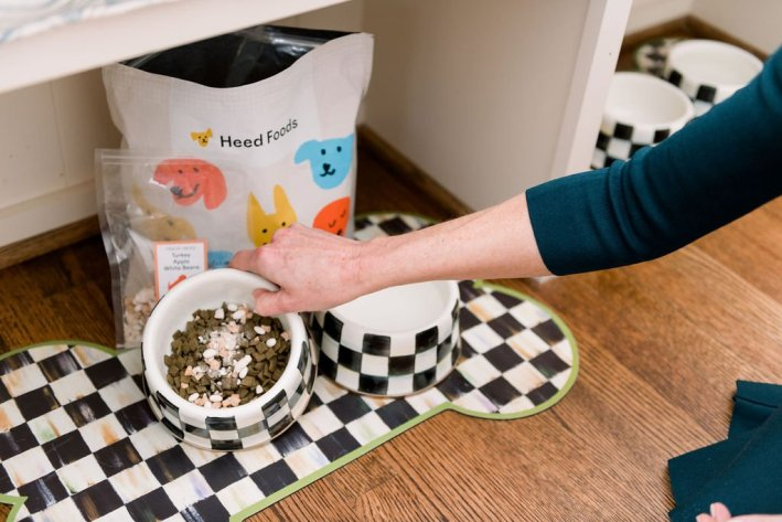 Heed Foods kibbles and topper in MacKenzie-Childs dog bowls
