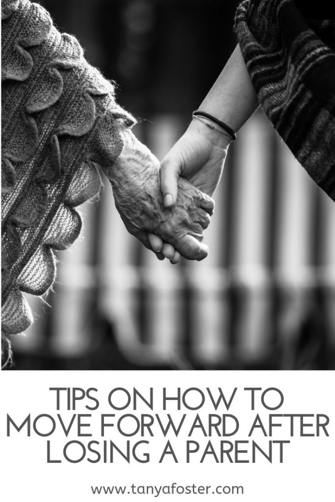 Tips on How to Move Forward After Losing a Parent by popular life and style blogger, Tanya Foster: black and white image of and elderly woman holding a younger woman's hand.