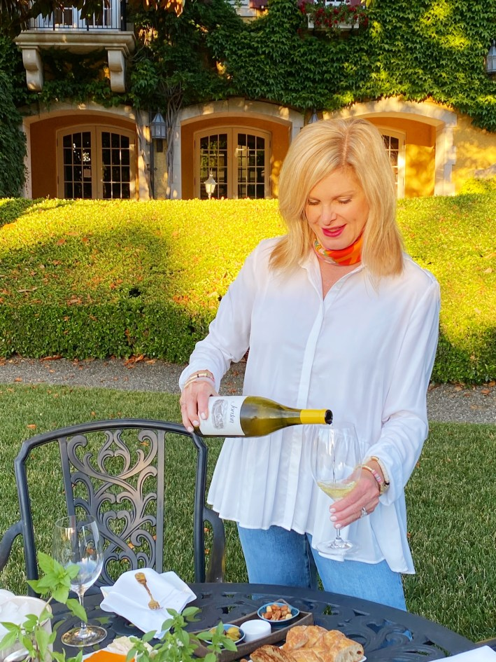 Tanya Foster pouring Jordan Winery Chardonnay
