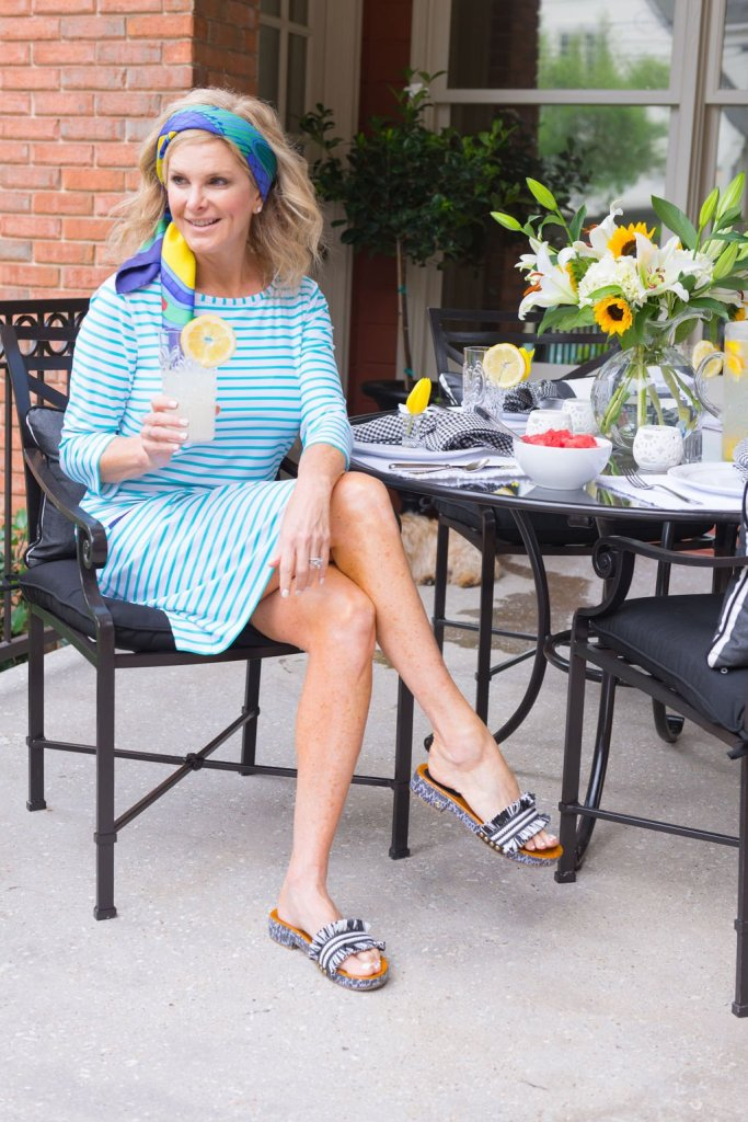 tanya foster in a cabana life dress and coach sandals