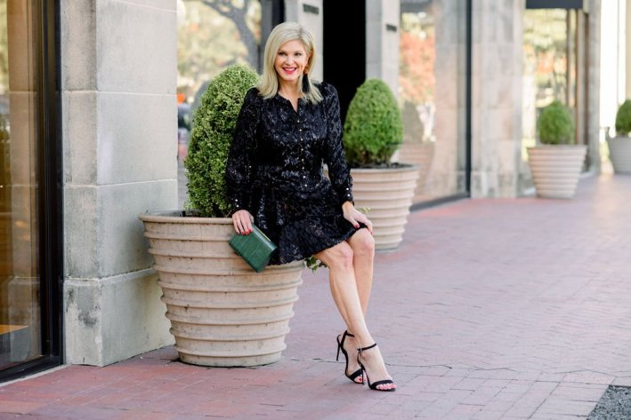 tanya foster wearing sail to sable leopard ruffle hem dress with tuckernuck statement earrings and officina del poggio clutch