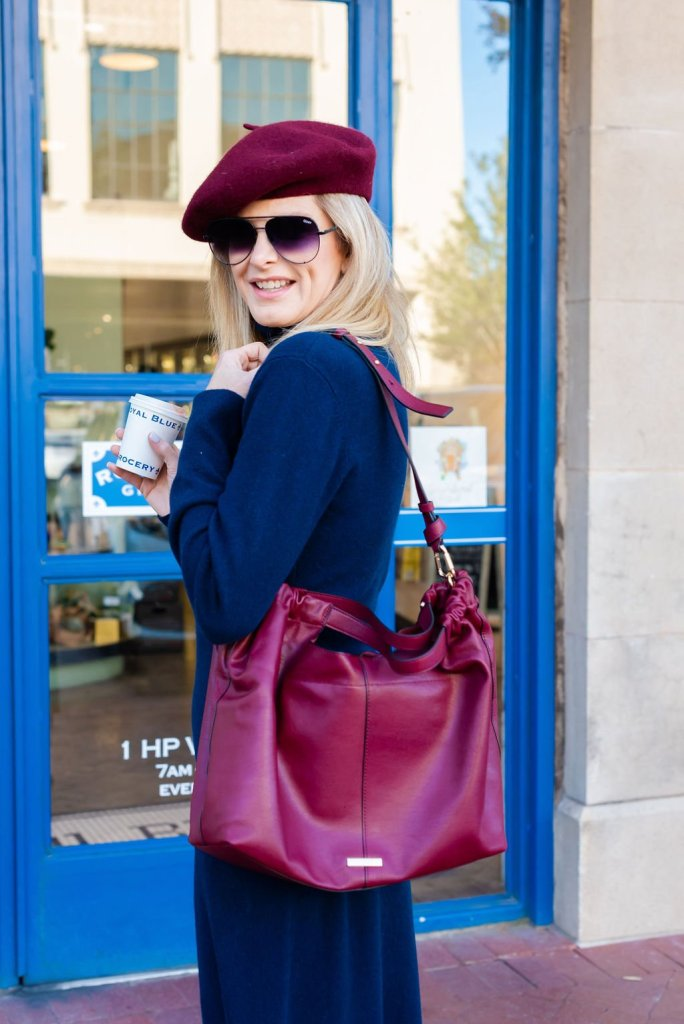 Tanya Foster holding a purse
