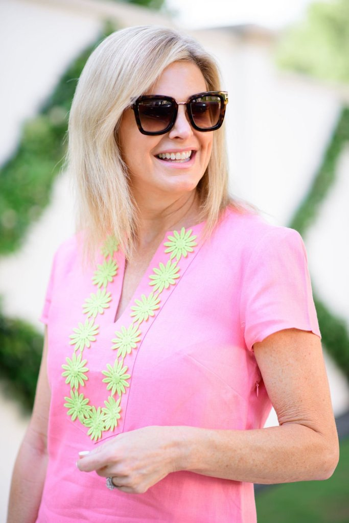 Tanya Foster in sail to sable pink embroidered dress for summer and tom ford sunglasses