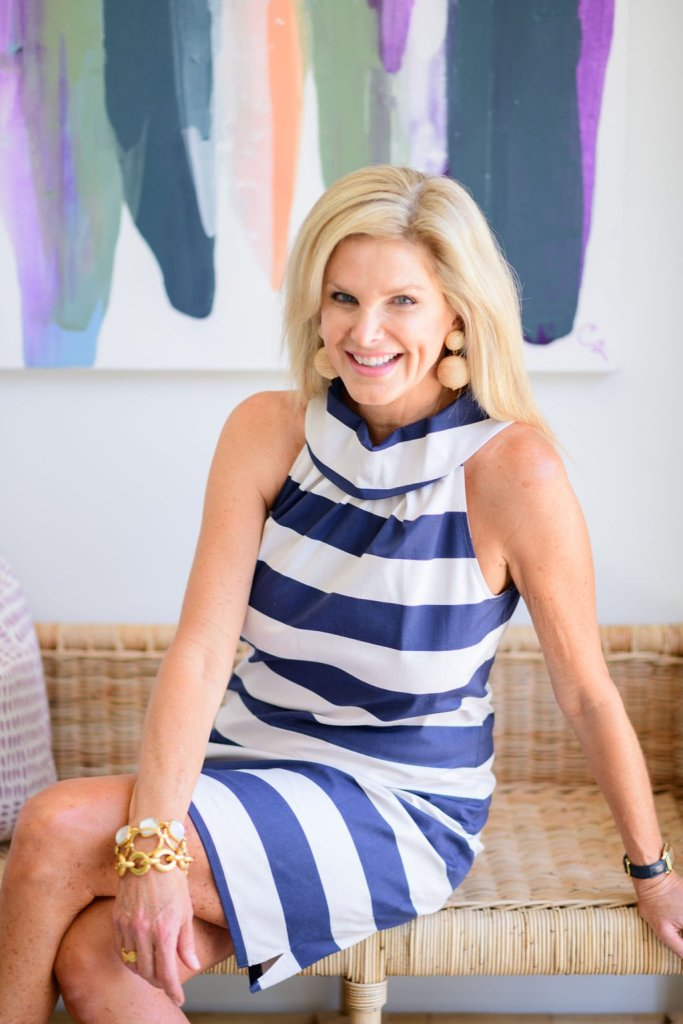Tanya Foster wearing sail to sable navy and white striped cowl neck dress with tuckernuck earrings