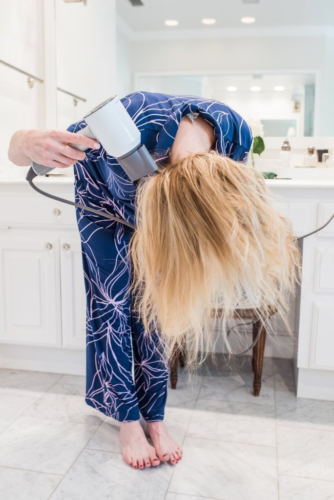 Tanya blow drying her hair with dyson hair dryer