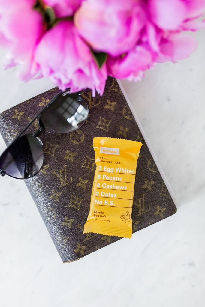 Sharing 5 bags that are worth the price and what's in my bag on TanyaFoster.com | 5 Best Designer Bags to Invest in and What's in my Bag by popular Dallas fashion blogger, Tanya Foster: image of a Louis Vuitton planner, sunglasses, and an RX bar.