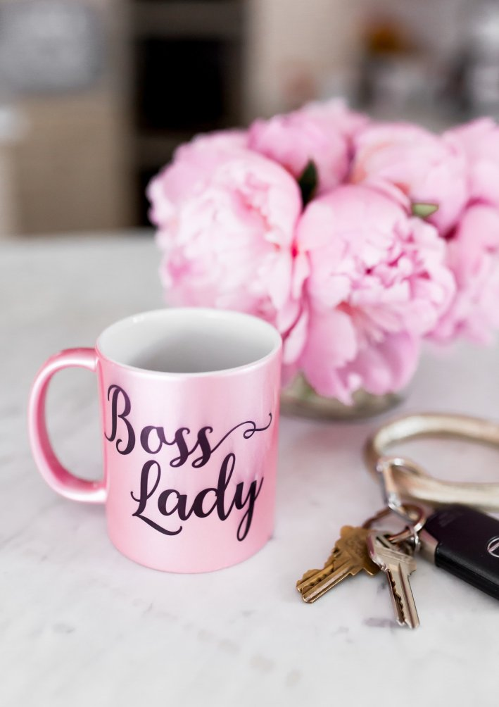 Boss Lady mug vase of flowers and keys on a counter