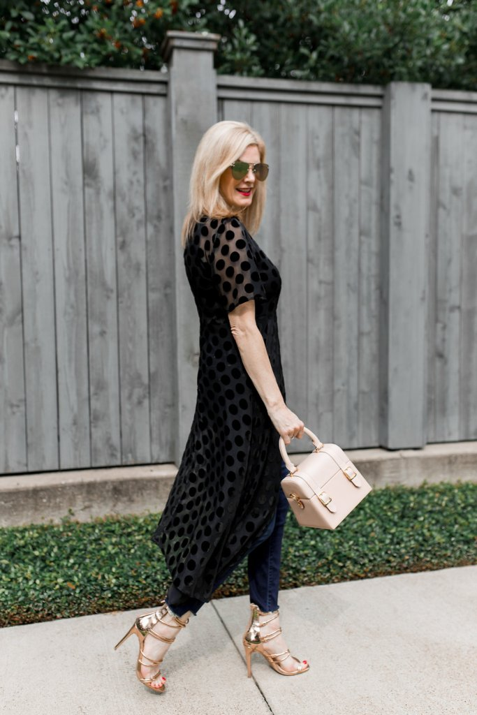 Tanya Foster gets out of her comfort zone by wearing a Zara sheer dress over a pair of Mother denim jeans with heels.