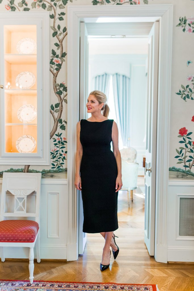 Tanya foster standing in a doorway in a black dress gifts under $25